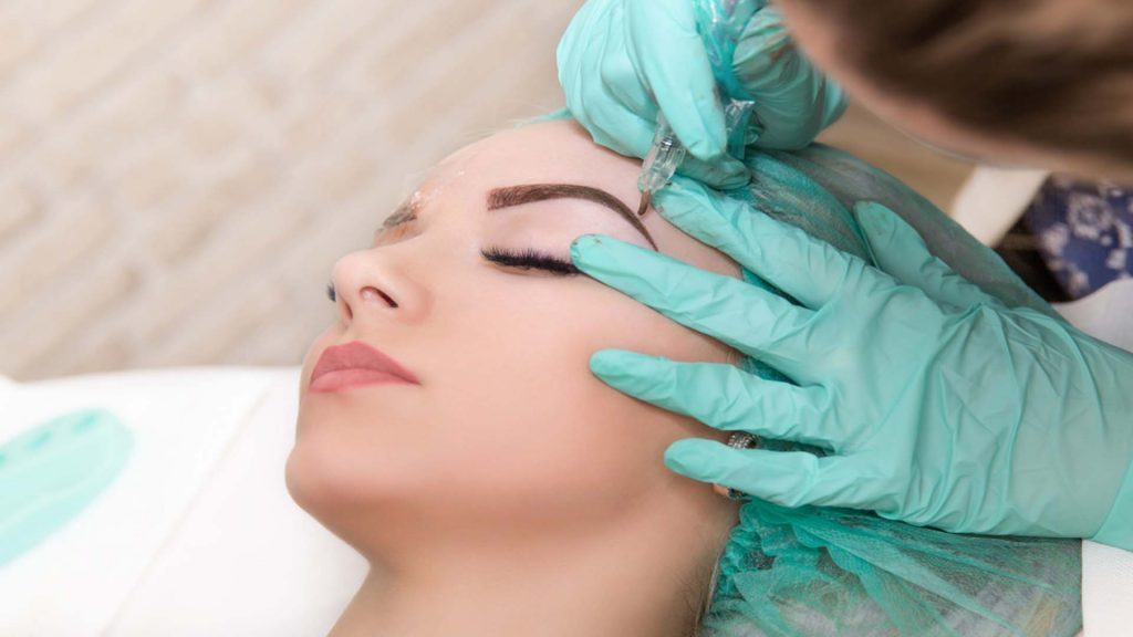 Lady Getting Her Eyebrows Done-Microblading